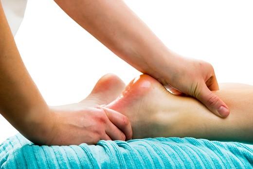 Stock Photo: 4148R-2549 Foot massage, a little taste of luxury.