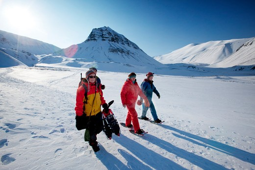 Stock Photo: 4148R-2579 A group of tourists and a guide near Longyearbyen, Svalbard, Norway