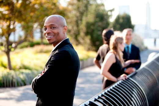 A group of business colleagues in the park - focus on front man : Stock Photo