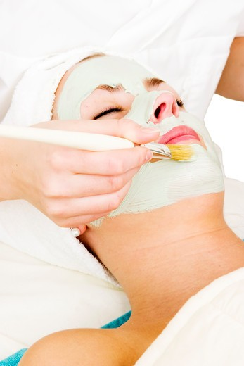 Stock Photo: 4148R-2635 A detail image of a green apple mask being applied at a beauty spa.