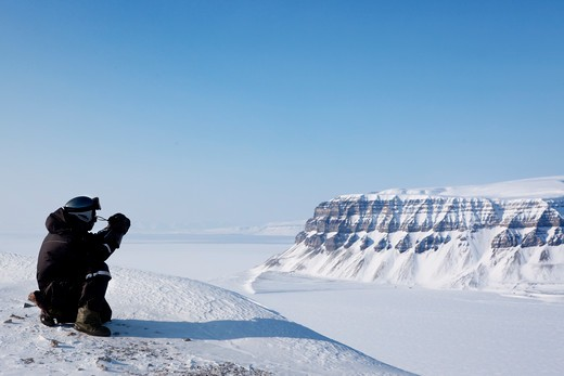 Stock Photo: 4148R-2653 A winter wilderness adventure guide.  Spitsbergen, Svalbard, Norway