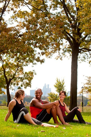 Stock Photo: 4148R-2654 A group of people relaxing in the park after exercise