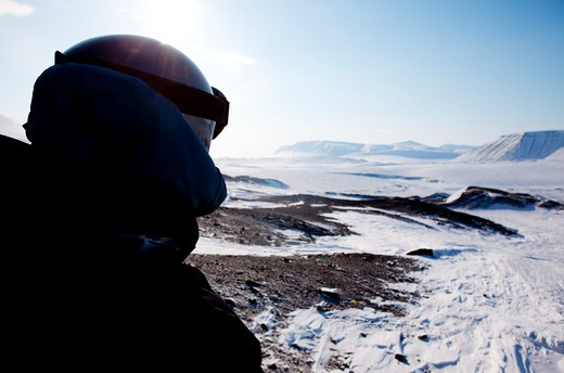 A winter adventure guide on a barren winter landscape : Stock Photo
