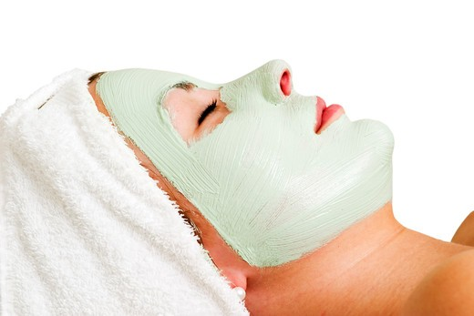 Relaxing with a green apple facial mask at a beauty spa. : Stock Photo