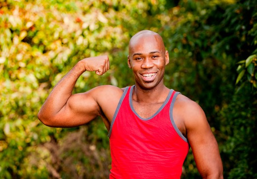 An African American man flexing his Bicep : Stock Photo