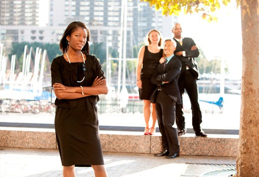 An African American woman in front of a business team : Stock Photo