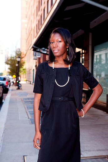 An African American business woman in an urban setting. : Stock Photo