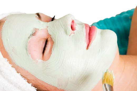 Stock Photo: 4148R-2745 A detail image of a green apple mask being applied at a beauty spa.