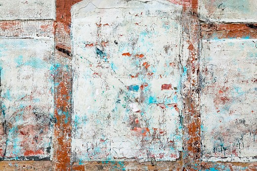 Stock Photo: 4148R-2843 Thick paint and paster slowly peeling off and cracking on an antique wood, brick and plaster building.