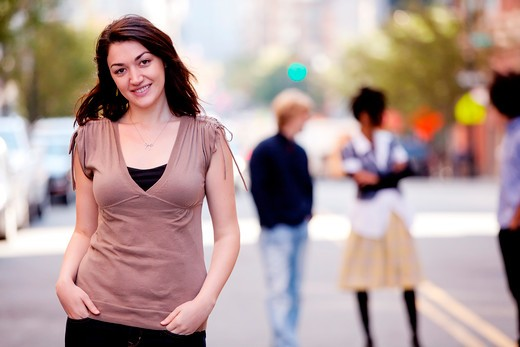 Stock Photo: 4148R-2883 A woman in a city setting with friends in the background