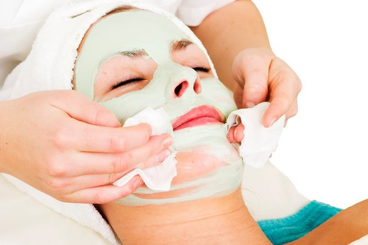Stock Photo: 4148R-2886 Detail of a facial mask treatment being wiped off the face.