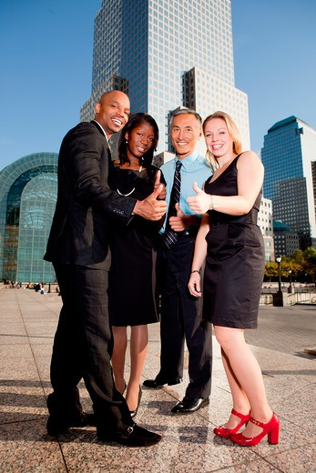A business team giving a thumbs up showing success : Stock Photo