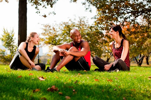 A group of people relaxing in the park after exercise : Stock Photo