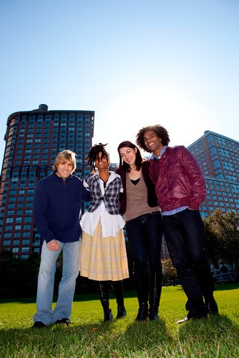 Stock Photo: 4148R-2927 Low angle view of four people in urban park. Vertically framed shot.