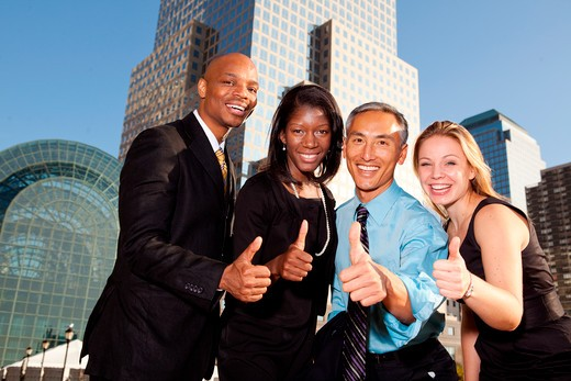 Stock Photo: 4148R-2982 Four business people giving thumbs up. Horizontally framed shot.
