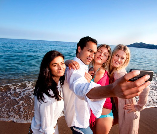 Stock Photo: 4148R-2987 A group of friends taking a self portrait - room for copy space at top