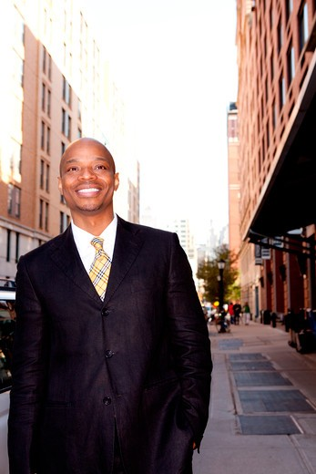 Stock Photo: 4148R-3007 A happy business man on a street in a city