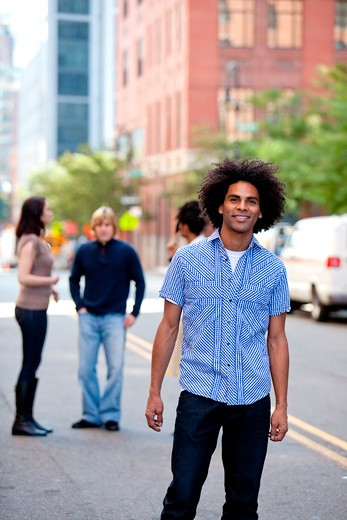 A young adult in a city setting with friends : Stock Photo