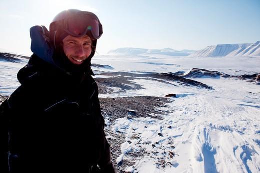 Stock Photo: 4148R-3016 A winter adventure guide on a barren winter landscape