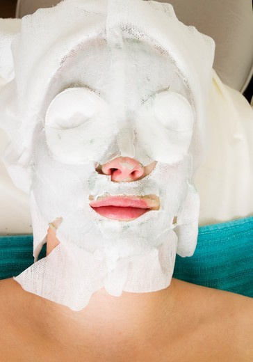 A detail of a facial mask being applied at a beauty Salon : Stock Photo