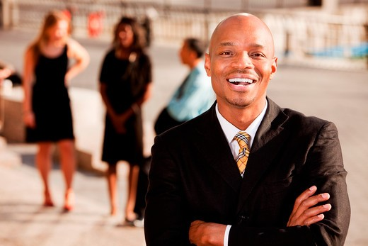 An portrait of an African American Business Man in an outdoor setting : Stock Photo