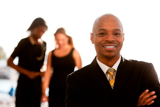 Stock Photo: 4148R-3058 An african american business man with colleagues in the background