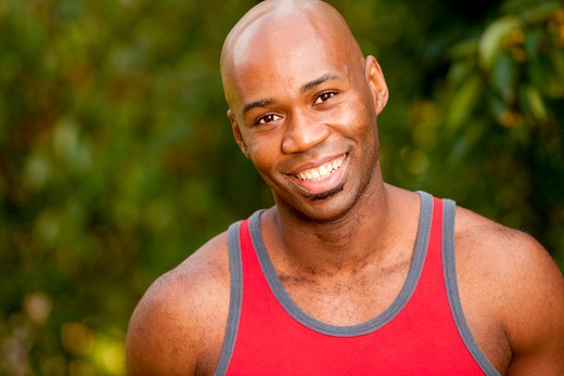Stock Photo: 4148R-3071 A portrait of an African American man taking a break while exercising