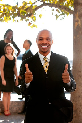 An african american business man with thumbs up : Stock Photo