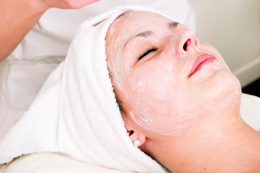 Relaxing during a facial treatment at a beauty spa. : Stock Photo