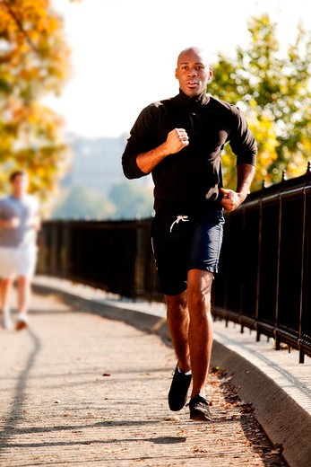 Stock Photo: 4148R-3123 An African American jogging in a park in the morning