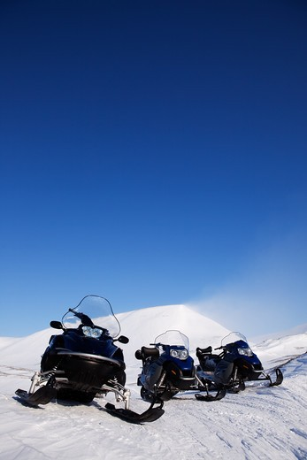 Stock Photo: 4148R-349 Three snowmobiles on an outdoor winter landscape