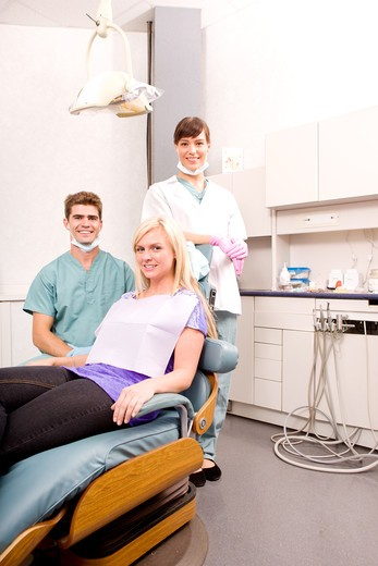 Stock Photo: 4148R-659 A dental clinic with dentist, assistant and patient