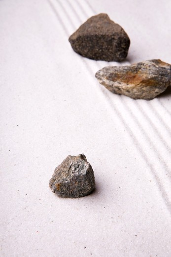 A rock in sand - zen rock garden : Stock Photo