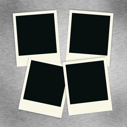 Four blank polaroid images on a brush aluminum background. : Stock Photo
