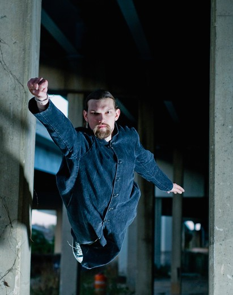 Stock Photo: 4152-102 Man pretending to be a superhero
