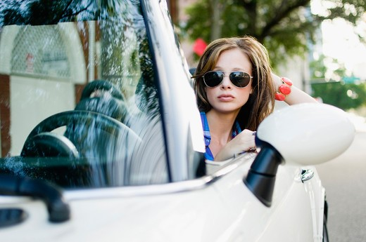Woman sitting in a car : Stock Photo