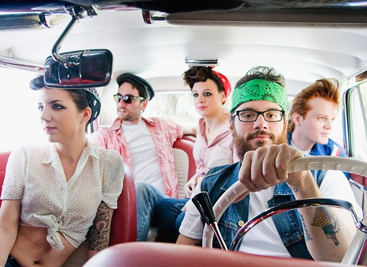 Friends traveling in a car : Stock Photo