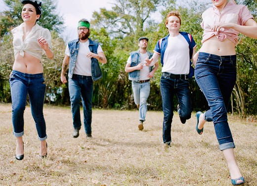 Friends running in a park : Stock Photo
