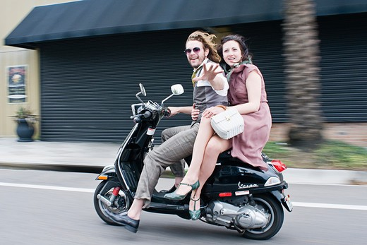 Stock Photo: 4152-130 Couple riding a scooter