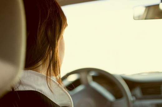 Stock Photo: 4152-132 Rear view of a woman driving a car