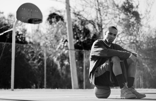 Stock Photo: 4152-148 Man sitting on a basketball