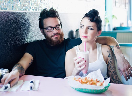 Couple having milkshake and snacks in a restaurant : Stock Photo