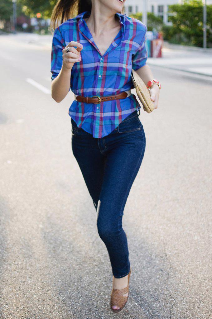 Stock Photo: 4152-185 Woman running on a street
