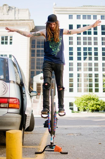 Man performing stunts on a bicycle : Stock Photo