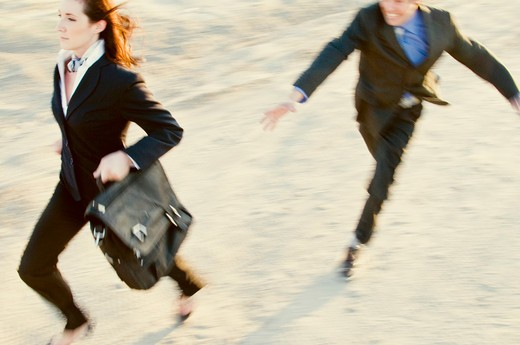 Stock Photo: 4152-197 Businessman chasing a businesswoman