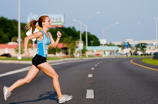 Female Athlete participating in a marathon race : Stock Photo