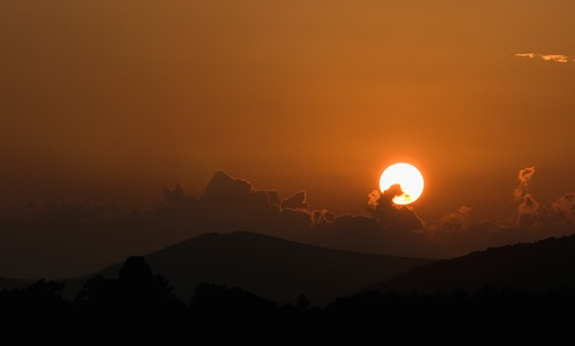 Silhouette of mountains at sunset : Stock Photo