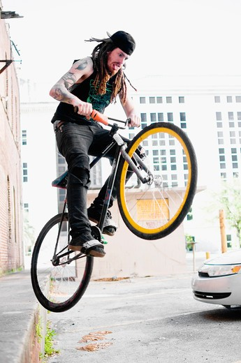 Stock Photo: 4152-205 Man performing stunts on a bicycle