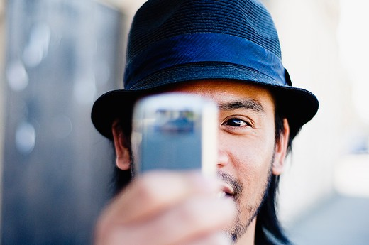 Stock Photo: 4152-209 Man taking a picture with a mobile phone