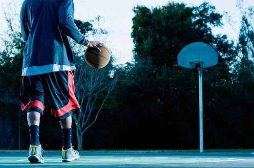 Stock Photo: 4152-217 Basketball player practicing in a court
